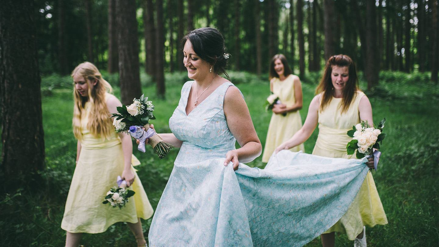 Bride with bridesmaids carrying train